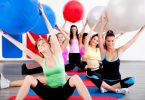"""People Doing Stretching Exercise With Fitness Balls"" by photostock"