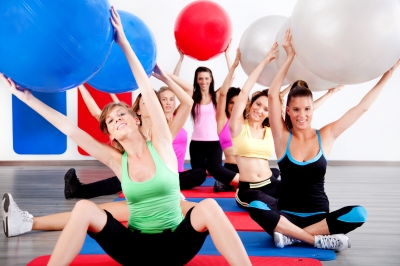 """""""People Doing Stretching Exercise With Fitness Balls"""" by photostock"""