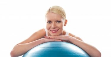 """""""Athlete Lady Resting Chin Over Ball"""" by stockimages"""