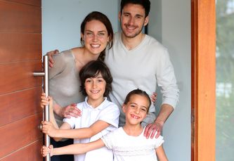 Family happy to welcome people in brand new home